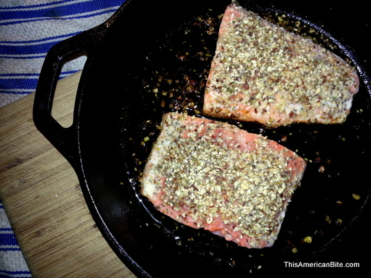 dukkah salmon in a cast iron skillet