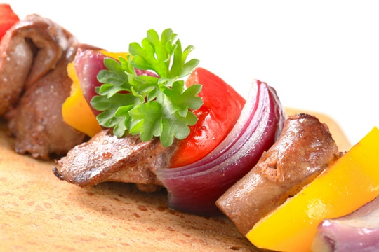 If you want to get your veggies cooked at the same time as your chicken, you could add red onion, peppers or tomatoes to your skewers.