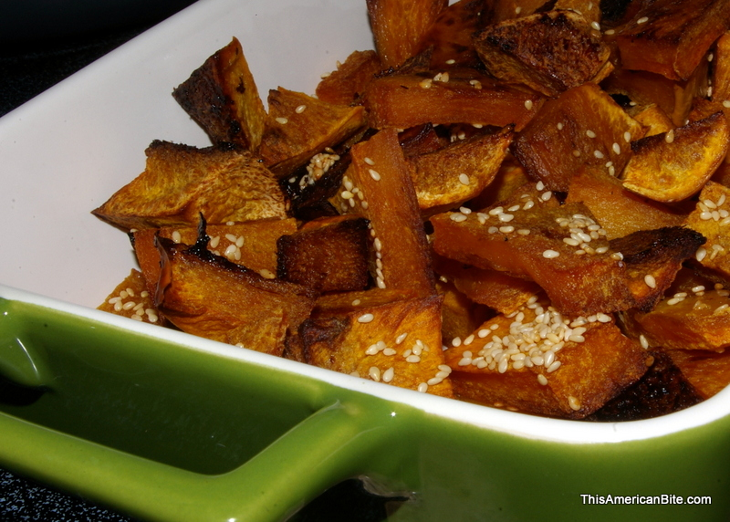 Roasted butternut squash in a green tray