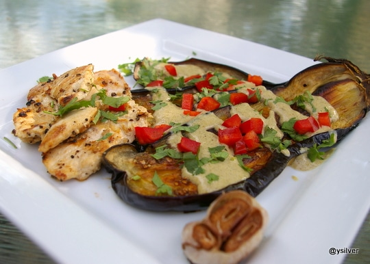 Roasted eggplant served with tahini and grilled chicken