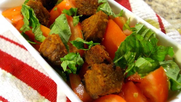 Tomato and basil salad with KOL Foods Kishke croutons