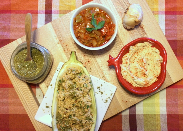 Israeli appetizers: Matbucha, hummus, eggplant dip and zataar.