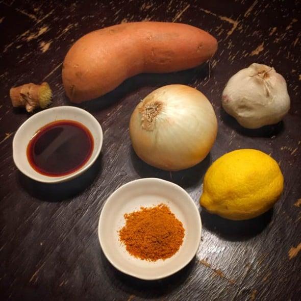 Sweet potato, teriyaki sauce, onion, garlic, lemon and curry powder for organic salmon curry